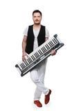 Intégral du musicien masculin avec le synthétiseur. Images libres de droits