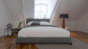 Intérieur de chambre à coucher avec le lit sous une pente de toit images stock