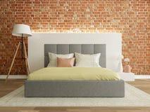 Intérieur de chambre à coucher avec le mur de briques, pièce moderne Photographie stock libre de droits