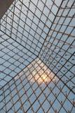 Intérieur de la pyramide en verre au Louvre Image libre de droits