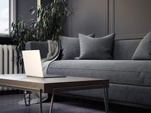 Intérieur gris avec l'ordinateur portable de table et d'argent rendu 3d Photos stock