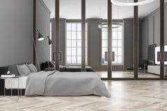 Intérieur gris de chambre à coucher, un poste TV Photo stock