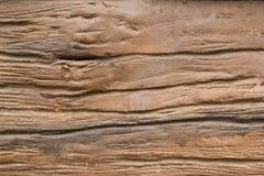 Intaglia una pietra di legno immagine stock