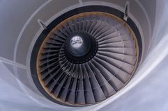 Intake and fan blade of a jet engine in Montreal, Canada. Intake and fan blade of a jet engine Royalty Free Stock Image
