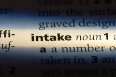 Intake. Word in a dictionary.  concept stock image