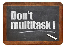 Inte gör multitask! Arkivfoton