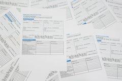 Inteckna ansökningsblanketter arkivbilder