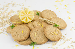 Integral biscuits and decorated lemon on white background Royalty Free Stock Images