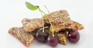 Integral biscuits with fresh cherry fruit  on white Royalty Free Stock Photos