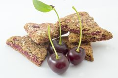 Integral biscuits with fresh cherry fruit  on white Stock Photos