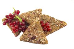 Integral biscuits with fresh currant and red berry fruit isolate Royalty Free Stock Photos
