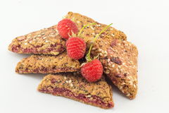 Integral biscuits with fresh raspberry. Integral biscuits with fresh red raspberry fruit Royalty Free Stock Image