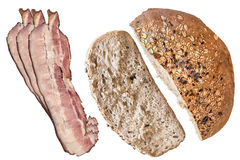 Integral Bread Loaf and Slice with three Bacon Rashers Isolated Royalty Free Stock Photos