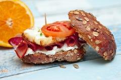 Integral bun with eggs, bacon and ham-Chrono diet. Integral bun with eggs, bacon and ham on the table-Chrono diet Stock Image