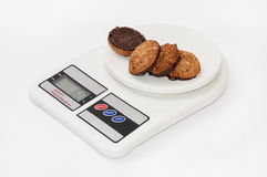 Integral chocolate cookies on the digital kitchen scale Stock Photo