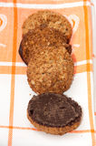 Integral chocolate cookies on the kitchen tablecloth Royalty Free Stock Photography