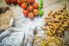 Integral components of tagliatelle pasta ingredients and tomatoe Royalty Free Stock Photos