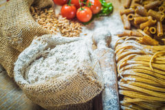 Integral components of tagliatelle pasta ingredients and tomatoe Stock Images