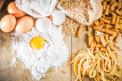 Integral components of tagliatelle pasta ingredients and tomatoe Royalty Free Stock Photo