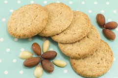 Integral cookies with almonds on blue dotted background Royalty Free Stock Photos