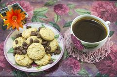 Integral cookies and chocolate balls on a colorful table Royalty Free Stock Images