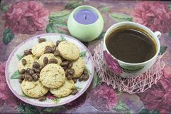 Integral cookies and chocolate balls on a colorful table Stock Photos