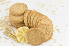 Integral cookies and decorated lemon on white background Royalty Free Stock Photos