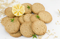Integral cookies and decorated lemon on white background Stock Images