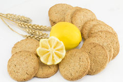 Integral cookies and decorated lemon on white background Stock Photos