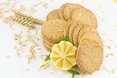 Integral cookies and decorated lemon on white background Royalty Free Stock Photo