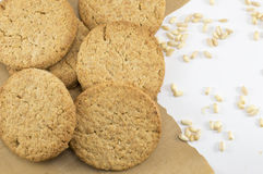 Integral cookies and wheat plant grains on a table Royalty Free Stock Photos