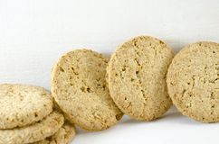 Integral cookies and wheat on white background Stock Photo