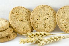 Integral cookies and wheat on white background Royalty Free Stock Image