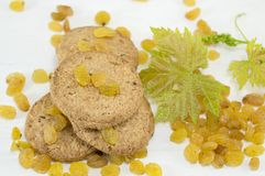 Integral cookies and yellow raisins Stock Photography
