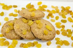 Integral cookies and yellow raisins Stock Photos