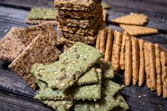 Integral crackers with healthy seeds royalty free stock image