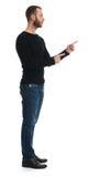 Integral del individuo barbudo que señala el finger algo imagen de archivo