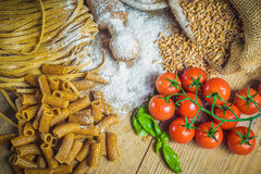 Integral pasta with ingredients ingredients and tomatoes. Stock Photo