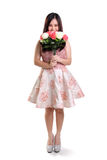 Integral tímido de la muchacha y de la flor aislado Fotografía de archivo