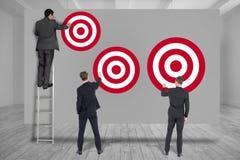 Integrale degli uomini di affari che prefiggono gli obiettivi immagine stock libera da diritti