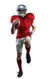 Integrale del giocatore di football americano nel funzionamento rosso del jersey fotografia stock