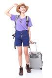 Integrale della giovane donna nella camminata casuale con la borsa di viaggio immagini stock