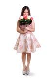 Integrale timido del fiore e della ragazza isolato Fotografia Stock