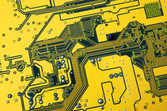 Integrated circuit. Photo of integrated circuits of a green and yellow computer board Stock Photos
