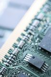 Integrated circuit. Close-up view of an green integrated circuit Stock Photography