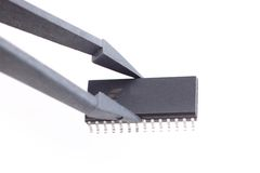 Integrated circuit. Holding an integrated circuit chip with white background Stock Photography