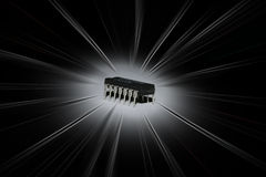 Integrated Circuit. Close-up of an integrated circuit over a black background with light effects Royalty Free Stock Photo