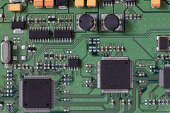 Integrated circuit board. Integrated electronic circuit board schematic with conductors on a computer microchip or processor for connecting and communicating Royalty Free Stock Photo