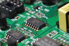 Integrated Circuit. A close up photo taken on an integrated circuit soldered on a printed circuit board Stock Images