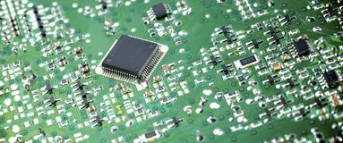Integrated Circuit. Closeup of a chip in an integrated circuit Royalty Free Stock Images